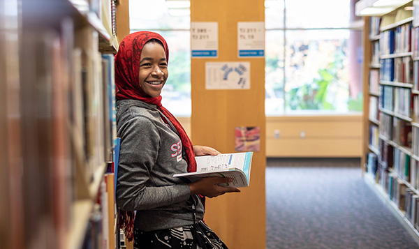 Student reading in the South Seattle College library