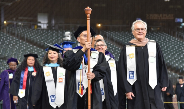 Seattle Colleges Chancellor Shouan Pan leads the graduation processional at the 2019 Commencement Ceremony